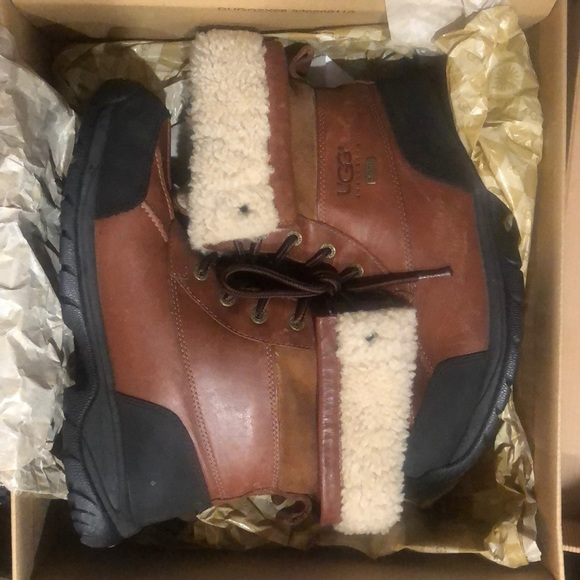 Brown and black uggs. Worn few scratches